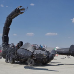 Gigantic scorpion sculpture vehicle blows fire from its tail